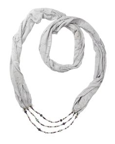 This light grey circular scarf necklace is made with Amethyst, Quartz, Fluorite and Grey Moonstone. This jewelry is designed to work with the Third Eye (6th) and Crown (7th) chakra and promotes mindfulness while enhancing meditation. It also helps one achieve balance of the emotional, physical, and spiritual bodies. AFFIRMATION:   I am aware of all of the beauty around me. I embrace my oneness with the Universe and strive for balance and interdependence.