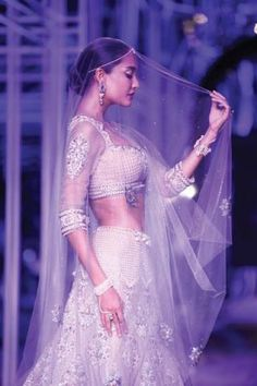 As the Aamby Valley India Bridal Couture Week comes to an end, we look back at some of the most stunning pieces on the ramp. Modern brides, bookmark Jyotsna Tiwari's patchwork lehengas and Adarsh Gill's minimalistic fuchsia saris. For...