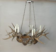 """A modern chrome and natural deer Horn pentagonal chandelier having eight lights. 31.5"""" H x 35.5"""" diameter. Recently professionally rewired with eight candelabra base sockets. We recommend that client's own electrical contractor verify all electrical fittings and connections."""
