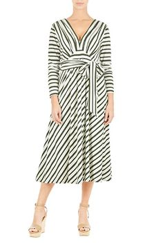 Angled empire waist banding and a low V-neck add chic sophistication to our sash tied jersey stripe dress in a flowy silhouette.