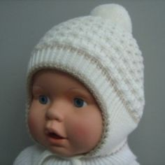 Двойная зимняя шапка на выписку из роддома можно заказать в интернет-магазине MamaEmma.ru