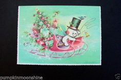 #H831- Vintage Unused Xmas Greeting Card Full Glittered Snowman on Pink Sleigh