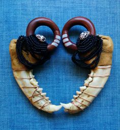 0 gauge ear weights saba wood coils with leather and by paperanji