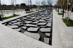 Roombeek the Brook - Buro Sant en Co -Enschede, the Netherlands Restoration of a stream brought up to the surface. Composition of sharp edged stepping stones refers to the randomness of natural processes and the fireworks explosion.