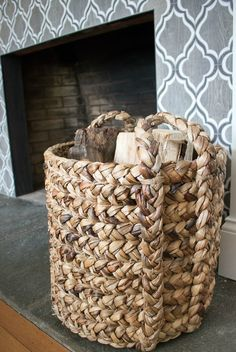 Stylish Fireplace Accessories A large woven basket used to store extra firewood by the fireplace - l