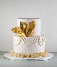 wedding cakes gold Pink and Gold Feather Cake Lil Miss Cakes 1920s Wedding Cake, 1920s Cake, Wedding Cake Pearls, White Wedding Cakes, Wedding Cake Designs, Great Gatsby Cake, Great Gatsby Wedding, Speakeasy Wedding, Gatsby Party