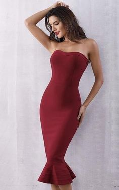 c5269c60c5d4 A new strapless sheath dress in red with a small mermaid flare at the hem.