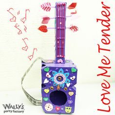 This Valentine's box will have you all shook up. Making a #Valentines Box that includes your child's favorite hobby is always a fun project, and in this case it's also very cute! Wally's Hint: If you want to go a step further, try making the instrument playable!