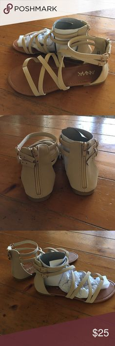 Strappy beige / tan sandals size 7 NWT Strappy beige / tan flat sandals size 7 New With Tags. Anna Shoes Sandals