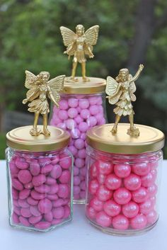 Fairy Party===Image Only---Glue plastic toy fairies to top of jar lids (you could use any small clean glass jar) and spray paint gold. Once dry add colored candy of your choice and you have a cute centerpiece that can also act as a party favor.