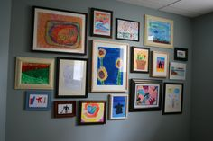 Kids' art gallery wall!  I got to make one of these and display those treasures!