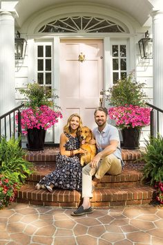 This Historic Colonial Home Gets a Modern Makeover: Lindsey and Grayson Cheek in front of their Wilmington, NC Home Front Door Landscaping, Colonial House Exteriors, Front House Landscaping, Michigan Cottage, Pink Front Door, Colonial Front Door, Modern Colonial, Exterior Makeover, Rustic Front Door