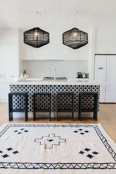 Black and white kitchen with Beni Ourian rug