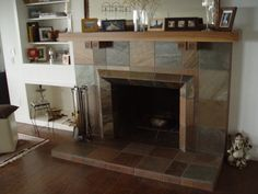slate fireplace... love how they have put them on the diagonal for the surround