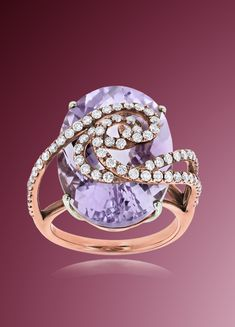 This 14K Rose Gold Amethyst Diamond Ring for Women showcases a beautiful 15-carat amethyst and 1.1 carats of sparkling round diamonds. Featuring a unique design, this fabulous diamond cocktail ring is available in 14K white, yellow and rose gold.