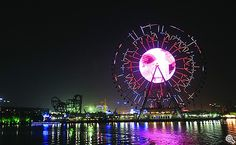 Suzhou Ferris Wheel is a 120-metre (394 ft) tall giant Ferris wheel on the east bank of Jinji Lake in Suzhou, Jiangsu, China. It has 60 passenger cabins, a maximum capacity of 300 passengers, and takes approximately 20 minutes to complete each revolution.