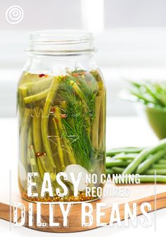 EASY no canning required dilly beans. Preserving food has never been so fun - or delicious! This simple recipe can be made in an afternoon, and you'll have dilly beans to snack on for months! Pickled Green Beans, Growing Squash, Grands Pots, Bean Plant, Healthy Afternoon Snacks, Healthy Snacks, Thing 1, Bean Recipes, Yummy Recipes