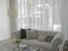 Sofia Joelsson's family room design at the Elle Decor House, Miami Beach, FL.   Parchment lamp, acrylic coffee tables, and Fish Skin Side table. www.sergedetroyer.com