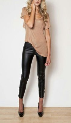 I love outfits like this! Black heels, black shiny leggings, and a nice loose fitting top. Casual yet classy.