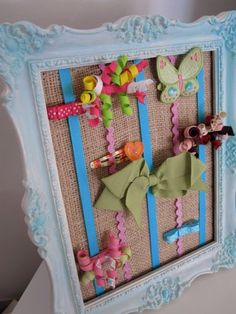 Cute little hairbow holder - so smart to use a picture frame that can stand up on the dresser and doesn't have to be hung.