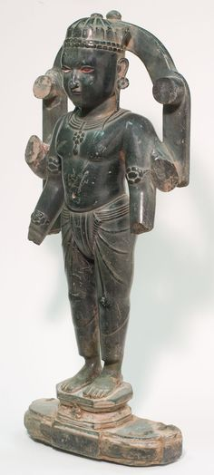 Standing Vishnu. 17th century. Multi-armed Vishnu, Hindu God of preservation, sustainer of the Universe, is carved from stone. Find important Asian art for sale on CuratorsEye.com.