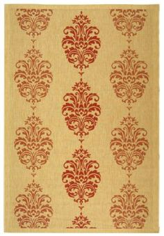 Subtle traditional details on this beige and coral rug