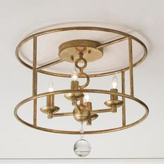 """Modern Cage Ceiling Chandelier Clean modern lines in this ceiling light give a strong start to a new and now room. In Bronze or Antiqued Gold (exclusive to Shades of Light), the play on circles make this flush mount chandelier even more interesting. Great fresh look for 8' ceilings! 4x60 watt candle sockets. (12.25""""Hx15""""W)"""