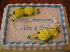Yellow Blue Anniversary Cake - I've been selling a lot of this design lately. This one is a sheet, marble cake, iced in buttercream. Buttercream roses and fondant daisies.