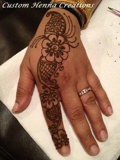 Henna on hand, mehndi, flower, paisley