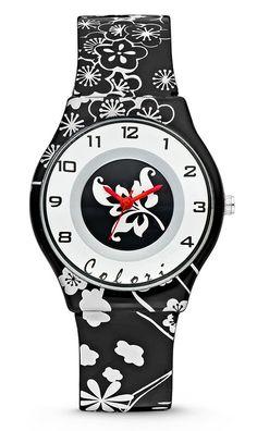 Colori kinderhorloge Funtime Flower zwart-wit 34 mm 5-CLK042. Trendy horloge voor trendy meiden. Het horloge is heeft een kunststof kast en horlogeband. De witte wijzerplaat is voorzien van duidelijke tijdaanduiding,bloemetjes en zilverkleurige- en zwarte accenten. De band is zwart/wit met bloemranken, het sluit door middel van een gespsluiting.