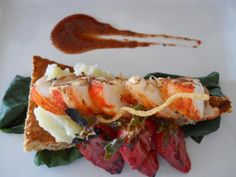 Jerk lobster medallions, on an herbed wafer with grilled strawberries. Rockhouse, Negril, Jamaica.