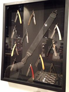 Fantastic framed collection of vintage straight razors.