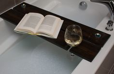 Our handmade quality wood bath caddy / board  Our Caddy's / board's have a slot perfect for your electronic device such as iPad/phone/tablet, flat bottomed hole for tea light candles & a slot for your wine glass to rest securely   We've designed our board wider than most making it safer when using iPads or Tablets.  Plus you can fit a lot more on with out feeling cramped for space.  All our boards are made from wood so they will have knots, grooves and grains in them. Wood Bath, Bath Tub, Tea Light Candles, Tea Lights, Bath Board, Electronic Devices, Bath Caddy, Primary Colors, Wine Glass