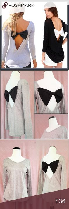"""NWT Gray long sleeve top with open back with bow ➖SIZE: small, medium  Small :  ➖Length :23""""-25""""  ➖Bust: 17.5""""       ➖Shoulder: 15""""  ➖Bow: 9"""" wide  Medium  ➖Length: 23.25""""-27""""  ➖Bust: 18""""  ➖Shoulder: 16.75""""   ➖Bow: 9.25"""" wide  ➖STYLE: Gray❗️ top with an open V shaped back with a black bow through the middle. This is a very unique top and the bow adds a lot of character to this otherwise simple gray top! ❌NO TRADE Entropy Tops Blouses"""