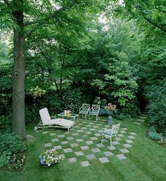 Checkerboard garden - use pavers to create a low budget backyard patio / sitting area