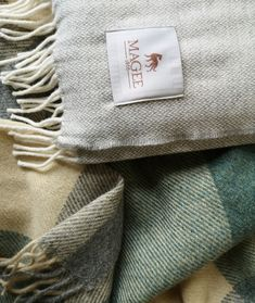 Spend chilly spring mornings wrapped up in our lovely woolen throws, designed and woven at Magee mill in Donegal, Ireland. The patterns and colours are inspired by the land and seascape that surrounds Donegal. Irish Design, Patchwork Designs, Donegal, Textile Design, Green And Grey, Cosy, Tweed, Picnic Blanket, Weaving