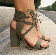 green heels and laced up heels image