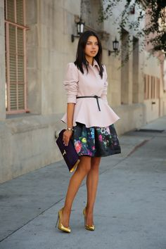 floral skirt and peplum blouse with gold pumps