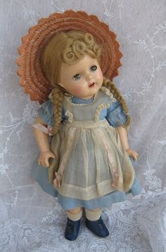 This adorable Madame Alexander doll dates 1937-1943 and is McGuffey Ana. She reminds me of Anne of Green Gables.