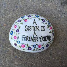 Lovely inspirational hand painted rock with whimsical flowers and words of wisdom about that very special relationship between 2 special people - SISTERS! A wonderful keepsake, reminder or gift!   Painted with acrylics and triple sealed for lasting durability. Measures approximately 3.5 x 3 x 1  Includes sturdy acrylic display stand!  Shipping is first class and limited to the continental United States.