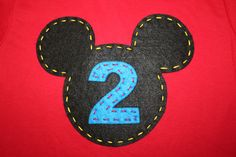 Mickey Mouse Clubhouse Birthday Party Shirt, Initial or Number, OR Disney Vacation Shirt, Mickey or Minnie Mouse, felt or fabric. $29.95, via Etsy.