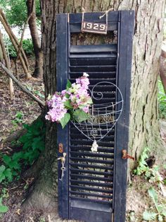 Blue shutter with purple lilacs. Vintage keys and beads to accent. Going into Barn Pretty soon!
