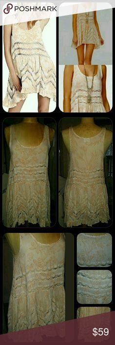 Free People Lace & Voile Trapeze Swing Slip Dress Bnwt  fp lace & Voile Trapeze Swing Slip Dress  SZ small  THIS has a print on it rather than the small Tiny dot it has a palm/floral like print . Color on tag is Creme and is an ivory with yellowish orangish color print like a cremesicle I guess u could say...neway it is new with tag never worn  WILL trade for other colors on my ISO listing  (pls see thee fp slips & thermals in search of listing. I need to update, lol cos I have now a bunch…