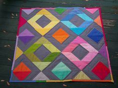 """cute mini quilt...1 charm pack of Kona + 2 5"""" charms, 7/8 yd grey  binding...would look great scaled up to a throw"""