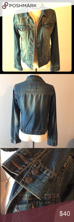 """Hollister Jean Jacket Hollister Jean Jacket.  Dark distressed wash denim.  5 button closure, two side pockets & two front chest flap pockets.  Adjustable tab buttons at waist.  Two cuff buttons at sleeve hems.  Size Small.  20"""" in length.  Excellent condition. No trades. Hollister Jackets & Coats Jean Jackets"""