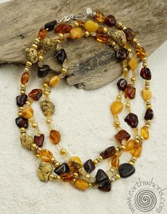 50% off this stunning amber, fresh water pearl and sterling silver necklace by EarthWhorls.  Code - ANCIENTAMBER - One of a kind, handmade, free shipping.
