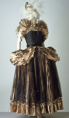 Ballgown Zandra Rhodes 1981 Printed quilted satin, printed silk net and knife-pleated polyamide/polyester/lamé mix Museum no. T.124 to C-1983