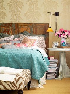 Textures - great bedding, love the repurposed #shutters #headboard, the #ROUND bedside table, the wall mounted sconce lights, but mostly the bedding combination with the turquoise blue quilted cover, the polka dot pillows and orange cushions... not to even mention the zebra ottoman! or Tropical palm wallpaper!