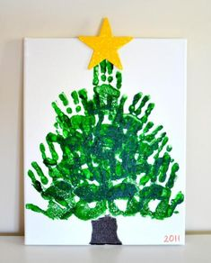 This handprint Christmas tree keepsake on canvas is my absolute favorite handprint craft we've ever made.  What's yours?@Tracey Freer