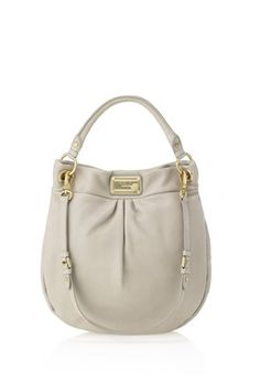Love the shape of this bag. It comes in so many fun colors too!!